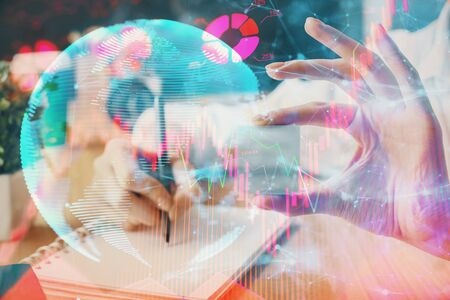 International business hud over womans hands writing background. Concept of hard work. Double exposure