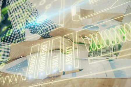 Science hologram with man working on computer on background. Concept of study. Double exposure. Banco de Imagens