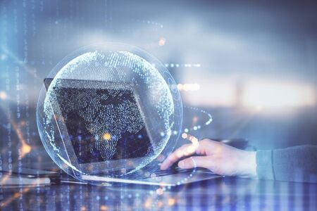 Multi exposure of world map hologram with man working on computer on background. Concept of worldwideweb. Banco de Imagens