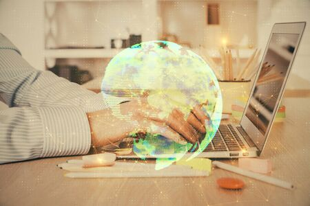 Social network theme hologram with businessman working on computer on background. Concept of world wide web. Multi exposure.