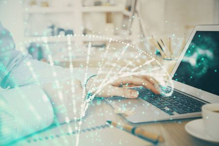 DNA hologram with businessman working on computer on background. Concept of bioengineering. Double exposure.