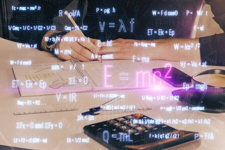 Man with mathematical and scientific formulas. Concepts of education. Symbols and equations on a virtual interface. Multi exposure. 免版税图像