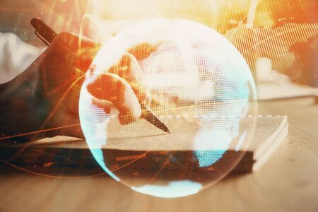 International business hud over woman's hands writing background. Concept of hard work. Double exposure