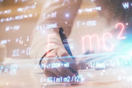 Student or teacher with mathematical and scientific formulas. Concepts of education. Symbols and equations on a virtual interface. Double exposure. Standard-Bild