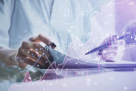 Financial chart drawn over hands taking notes background. Concept of research. Multi exposure Stockfoto