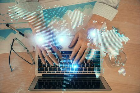 Social network theme hologram with businessman working on computer on background. Concept of world wide web. Double exposure.