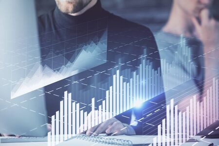 Forex graph with businessman working on computer in office on background. Concept of analysis. Double exposure. Imagens