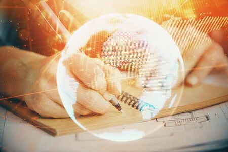International business hologram over womans hands taking notes background. Concept of success. Double exposure