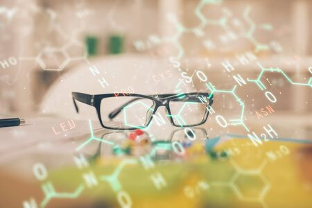 Formulas drawing with glasses on the table background. Concept of science. Double exposure. Stok Fotoğraf
