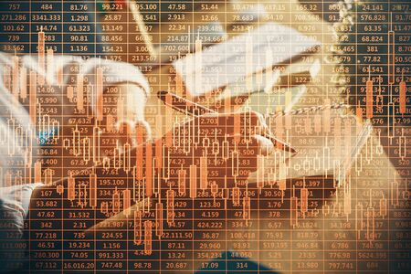 Financial forex charts displayed on womans hand taking notes background. Concept of research. Double exposure Imagens