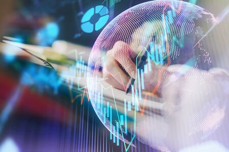 Financial forex graph drawn over hands taking notes background. Concept of research. Multi exposure