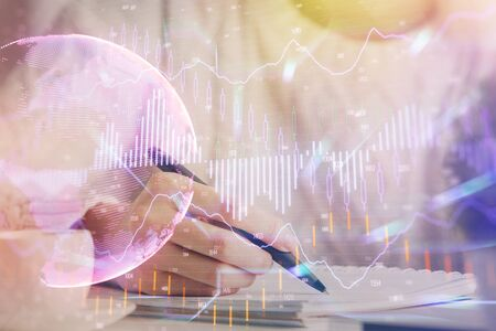 Forex chart displayed on womans hand taking notes background. Concept of research. Multi exposure