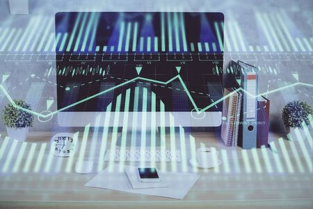 Double exposure of table with computer on background and data theme hologram. Data technology concept. Stockfoto