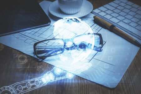 Map hologram with glasses on the table background. Concept of globalization. Double exposure.