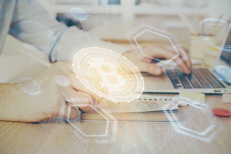 Blockchain theme hud with businessman working on computer on background. Concept of crypto chain. Double exposure.