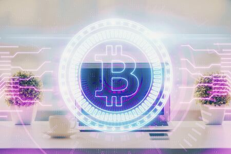 Double exposure of blockchain and crypto economy theme hologram and table with computer background. Concept of bitcoin cryptocurrency.