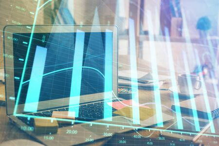 Stock market graph and table with computer background. Multi exposure. Concept of financial analysis. 版權商用圖片