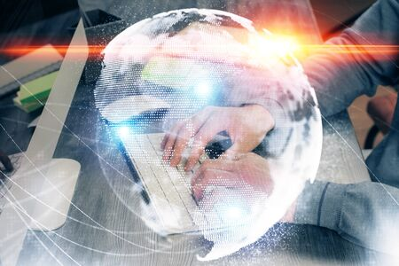 Double exposure of businessman working on laptop on background. International business hologram in front. Concept of success.
