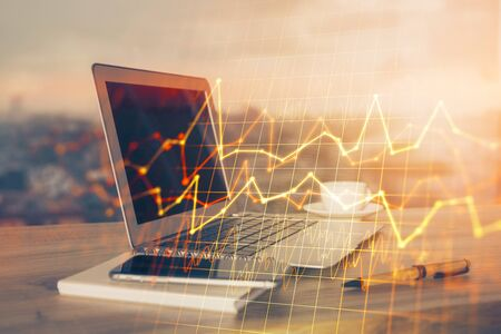 Double exposure of forex chart and work space with computer. Concept of international online trading.