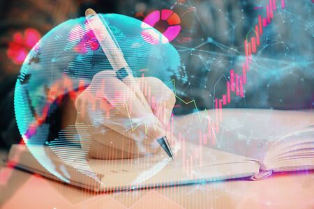 International business hologram over hands taking notes background. Concept of success. Multi exposure