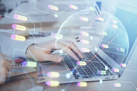 Multi exposure of world map hologram with man working on computer on background. Concept of worldwideweb. Stock Photo