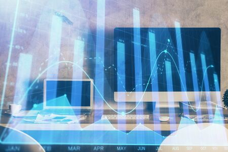 Double exposure of forex chart and work space with computer. Concept of international online trading. Banco de Imagens