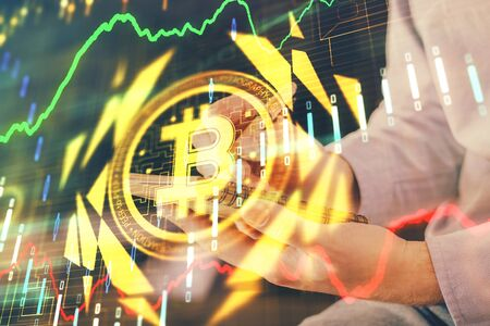 Mans hands working with notes background. Cryptocurrency and finance concept. Banco de Imagens