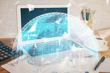 Double exposure of business theme icons and work space with computer background. Concept of success.