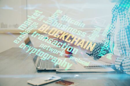 Blockchain theme hud with man working on computer on background. Concept of crypto chain. Double exposure.