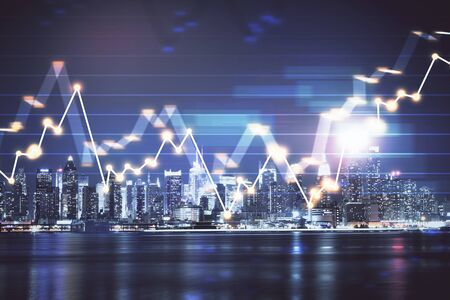 Financial graph on night city scape with tall buildings background multi exposure. Analysis concept. 写真素材