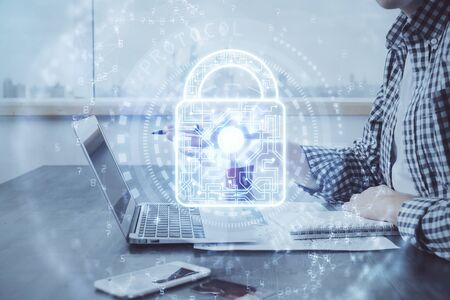 Double exposure of lock icon with man working on computer on background. Concept of network security.
