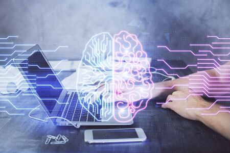 Man typing on keyboard background with brain hologram. Concept of big Data.