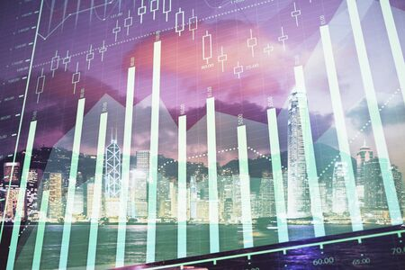 Double exposure of forex chart drawings over cityscape background. Concept of success. 스톡 콘텐츠