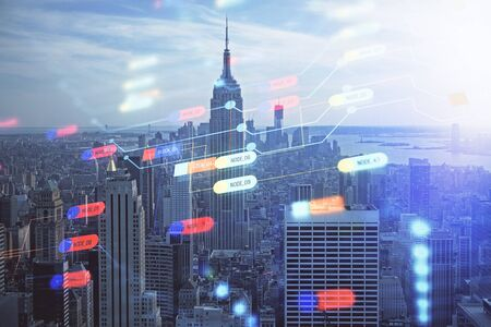 Data theme hologram drawing on city view with skyscrapers background double exposure. Technology concept. 스톡 콘텐츠