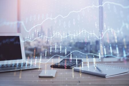 Forex graph hologram on table with computer background. Multi exposure. Concept of financial markets.
