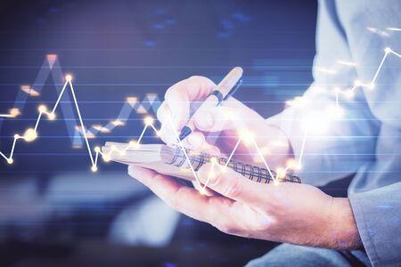 Double exposure hands with stock market chart. Zdjęcie Seryjne