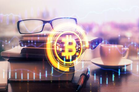 Crypto theme hologram with glasses on the table Stock Photo