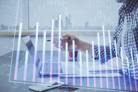 Double exposure of stock market chart with man working on computer 写真素材
