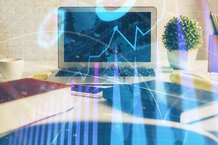 Stock market graph and table with computer background. Multi exposure. Concept of financial analysis. Stok Fotoğraf