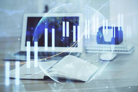 Forex market chart hologram and personal computer background. Double exposure. Concept of investment. Stok Fotoğraf