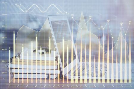 Forex market chart hologram and personal computer background. Double exposure. Concept of investment. Фото со стока - 129245500