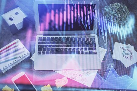 Financial graph colorful drawing and table with computer on background. Double exposure. Concept of international markets. Фото со стока - 129245506