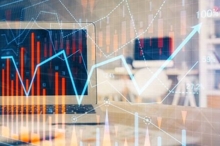 Stock market graph and table with computer background. Double exposure. Concept of financial analysis. Фото со стока - 129245418