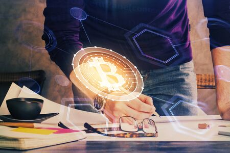 Mans hands working with notes background. Cryptocurrency and finance concept. Stockfoto