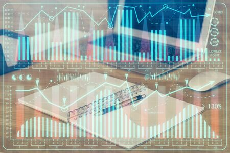 Double exposure of forex graph and work space with computer. Stock fotó