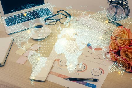 Double exposure of business theme icons and work space with computer 写真素材