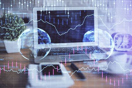 Financial market graph hologram and personal computer Stock Photo