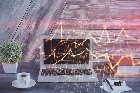 Double exposure of forex graph and work space with computer. Stock Photo