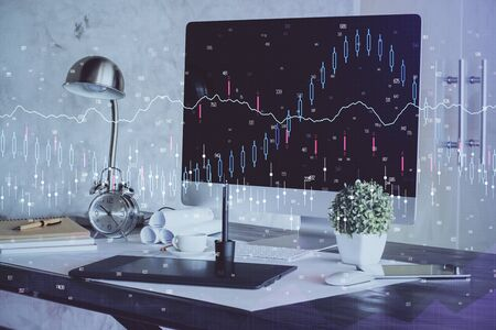 Financial chart drawing and table with computer