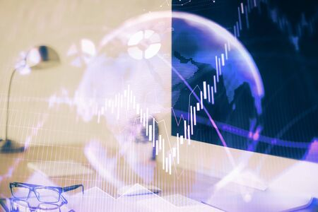 Forex graph hologram on table with computer 写真素材